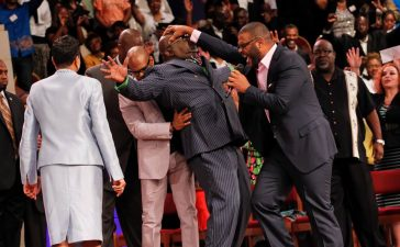 Tyler Perry lays hands on T.D. Jakes