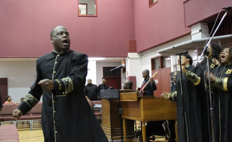 Patrick Lundy directs choir