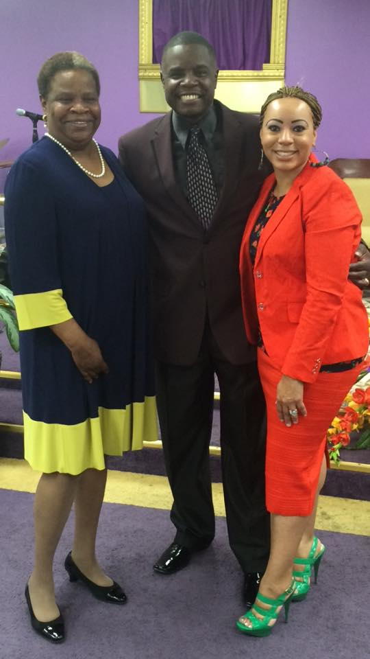 Pator Jerome Bell and his mother and wife at celebration