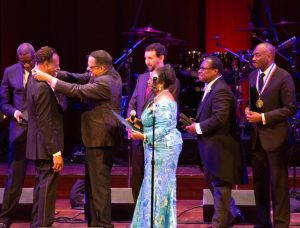 Richard Smallwood presents Edwin Hawkins with his medal during the Evolution of Gospel Concert at the Kennedy Center. (Photo credit: Milton Miller)