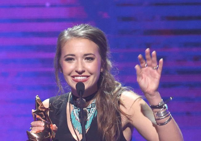 "The night's leading winner Lauren Daigle accepting ""Artist of the Year"" award"