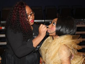 Denyelle Duckett makes up student portraying Diana Ross