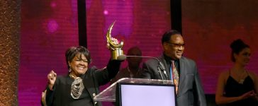 Honoree Dr. Shirley Caesar (L) accepts her award on stage from Dr. Bobby Jones (R) at the GMA Honors