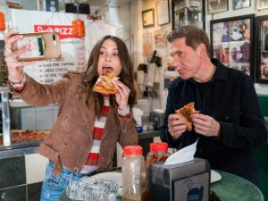 Bobby Flay and daughter enjoying burger