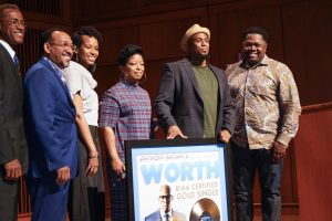 Anthony Brown stands with his gold record