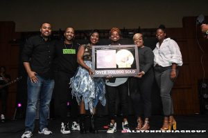 Travis Greene receives plaque for Gold certification